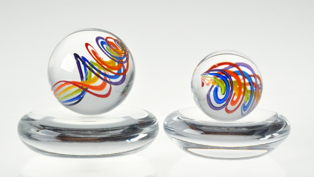 Beautiful, glass marbles containing colorful glass swirls. Glass stands included.